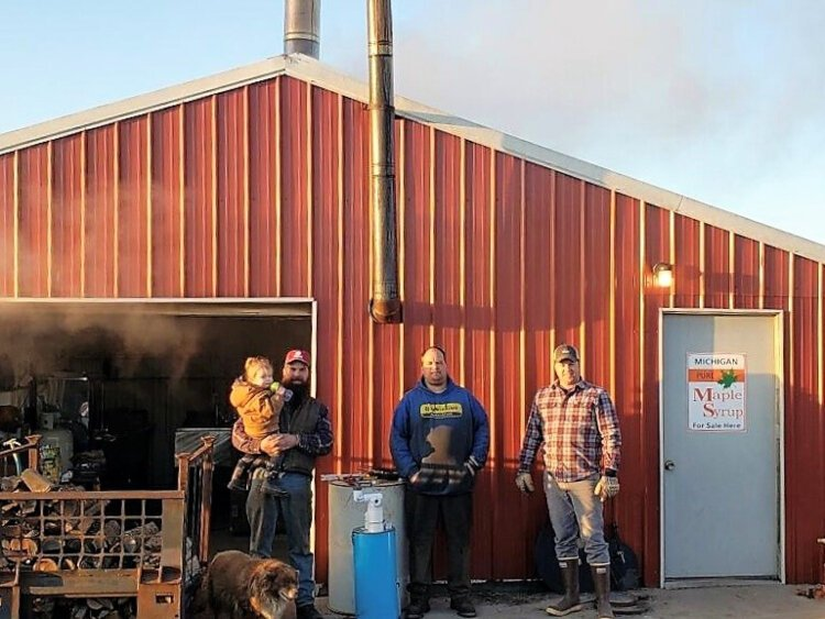 Sugar Bin owners built a larger building for on the farm to accommodate increased production. From left, Dave Ten Brink, Mark Raterink, and Ted Costigan.