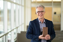 "Holland BPW's Pete Hoffswell was honored as Innovator of the Yearfor the ""smart brick"" he invented, which collects temperature data throughout the city's snowmelt system."