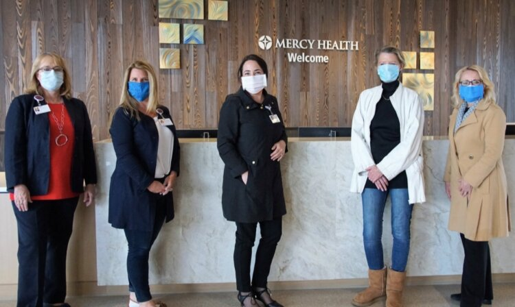 Herman Miller employees deliver donated masks and other PPE to Mercy Health.