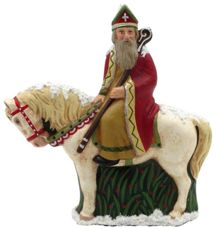 St. Nicholas, known as Sinterklaas, rides a horse in the Netherlands. Papier mache figure made by Susan Brack, Liberty, Indiana, from a German Anton Reiche chocolate mold dated around 1930.