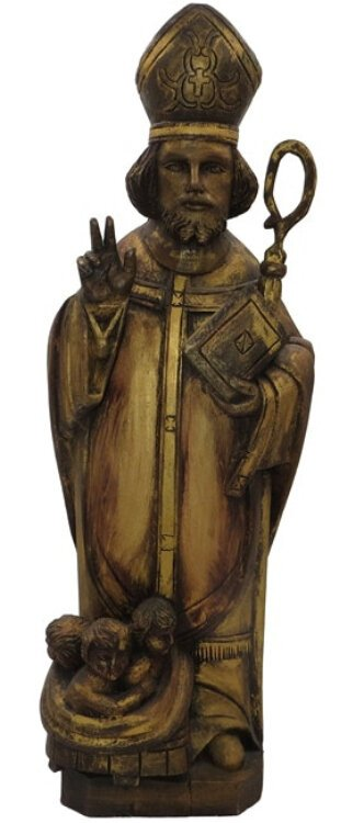 This antique wood carving probably came from a chapel in Belgium; it shows again the children St. Nicholas rescued.