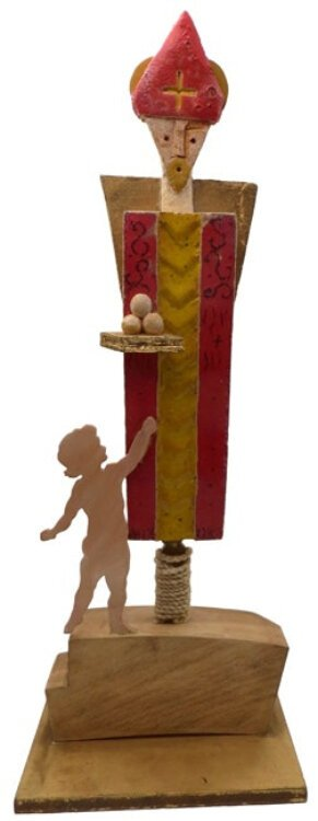 Artist Anna Maria Di Terlizzi's work often focuses on St. Nicholas joyous relationship to children; ceramic & wood sculpture, Bari, Italy.