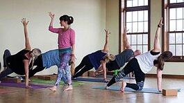 This prepandemic photo shows yoga instructor Julia Fisher leading a yoga class. She's helping people find connection through yoga at several lakeshore studios.