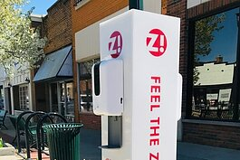 Two outdoor hand sanitizing stations have been placed in high-traffic areas along Main Street