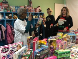 Volunteers set up the annual Holiday Store where clients can shop for what they need.
