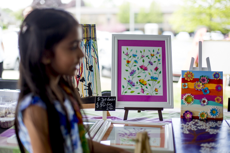 Meera Dani sells artwork at the Acton Children's Business Fair in Rochester