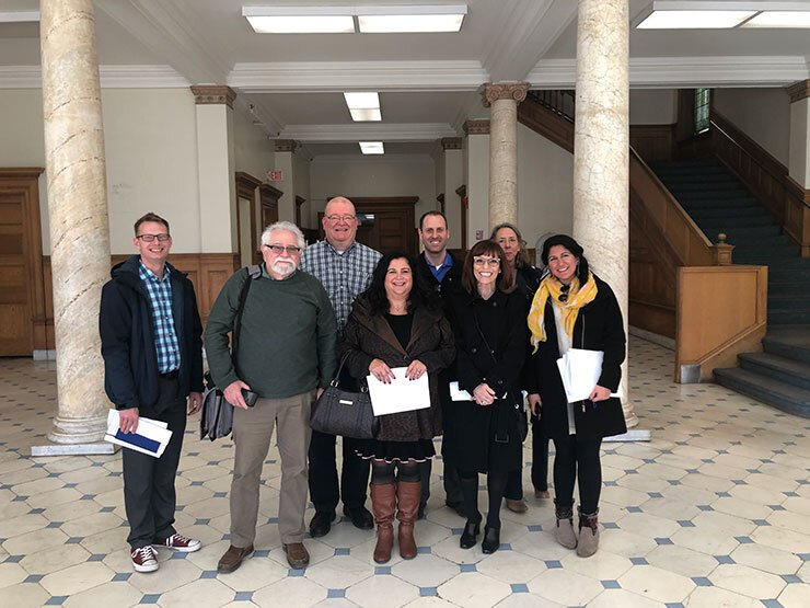 Anton Artspace steering committee in the lobby of the old St. Joseph Hospital on North Avenue,