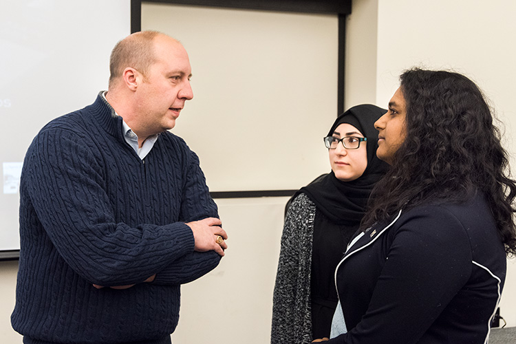 Michigan State Senator (23rd District) Curtis Hertel Jr  with U of M Dearborn student government vice president Malak Nasser and U of M Dearborn Student council president Fiana Arbab. Photo by Doug Coombe