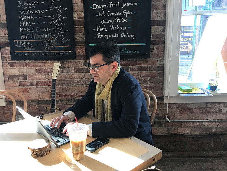 Attorney Eric Dobrusin working at the Alleycat Cafe. Photo by Nina Ignaczak.