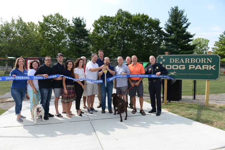 City leaders and sponsors stood in for the ceremonial ribbon cutting at the new Dearborn dog park Aug. 19. Photo by Jessica Strachan.