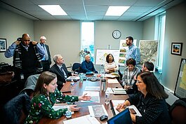 Partners meeting to plan for the future of the Mill Street Development site. Photo by David Lewinski.