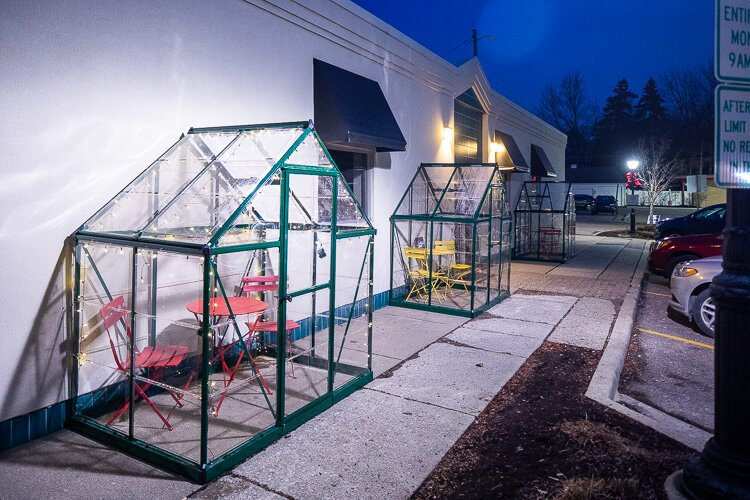 Greenhouses have been converted to outdoor dining pods in downtown Farmington
