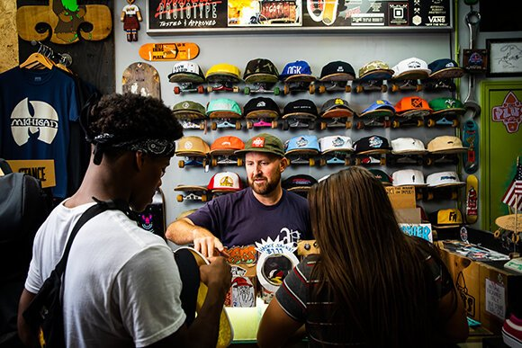 Rob Woelkers and customers at PLUSkateboarding. Photo by David Lewinski.