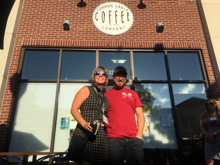 Cristina Decius-Sheppard, director of Downtown Dearborn,, and Dale Tremblay Dulong, owner of Common Grace Coffee, pose for a photo during the International Council of Shopping Centers East Michigan P3 Program tour on Oct. 5.