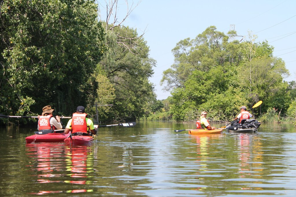 Community members explore Ecorse Creek. Photo by  Quentin Rodriguez