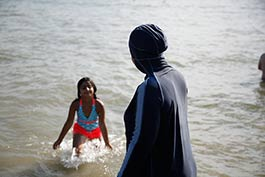 list-E.H.-taking-her-daughter-for-a-swim-at-Cass-Lake.jpg
