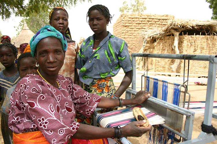 Images from Burkina Faso, where the women weave hundreds of meters of fabric on outdoor looms every year/