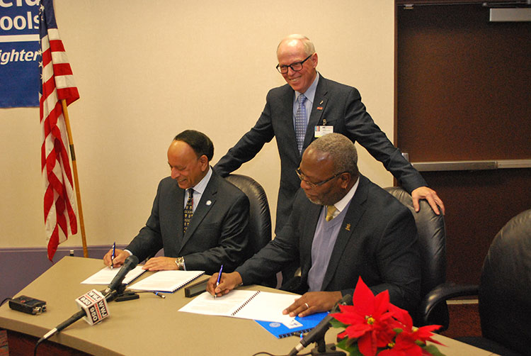 Lawrence Technological University President Virinder Moudgil and Southfield Public Schools Interim Superintendent Derrick Lopez signed the Blue Devil Southfield Scholars agreement.
