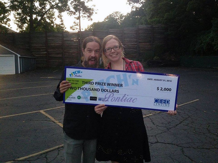Ashleigh Altemann and Evan Monaghan with their Pitch Pontiac winnings.