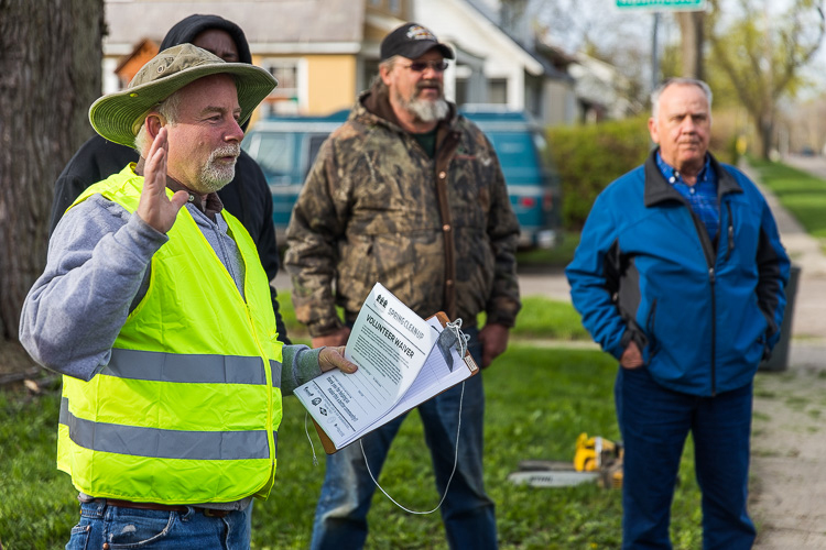 Tim Travis, owner of the Goldner Walsh nursery, give volunteers an Earth Day cleanup pep talk.  Photo by David Lewinski.