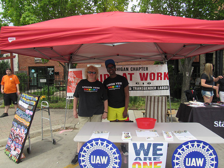 ill Daniels, right, with a member of Pride at Work Michigan, Photo by Micah Walker.