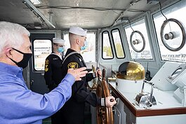 Captain Luke Clyburn speaks with Sea Cadets on the Pride of Michigan.