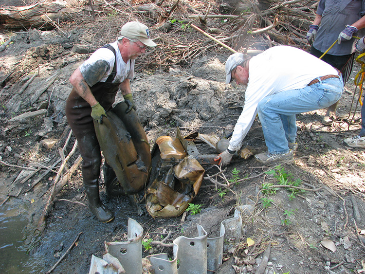 Volunteers remove debris from the Rouge River.