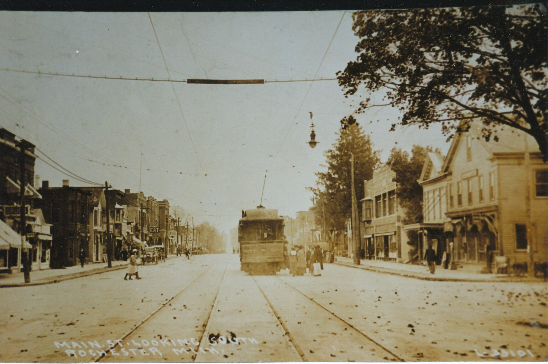 Looking south down Main Street at the Fifth St (now University Dr) intersection. The corner building on the right is the current location of Bean and Leaf.