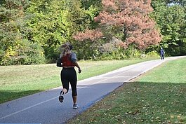 A runner hits the trail at Stony Creek Metropark.
