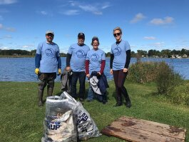 Volunteers clean up the Clinton River at Dodge Park in Waterford..