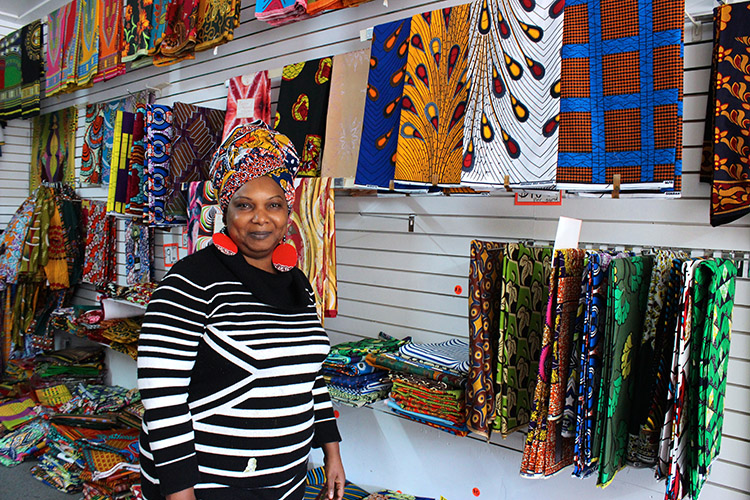 "Classic Expressions owner Yemisi ""Dammy"" Bamisaye poses alongside some of her wares. Photo by Sarah Rose Sharp."