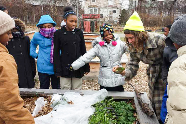 Young Detroiters learning about growing healthy food