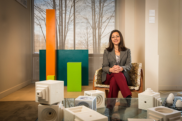 Leila Matta Art Programs Manager at Mercedes-Benz Financial Services, sits in a piece of functional art that is on display in the company's headquarters lobby. All of the art shown here is on loan from students and graduates of Cranbrook Academy of A
