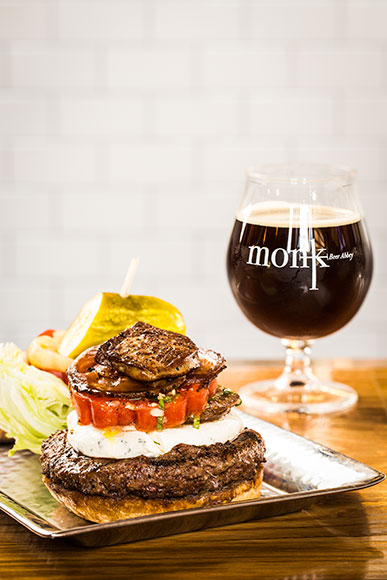 Monk's Burger with Foie Gras, Herbed Goat Cheese, Pancetta, and Marinated Tomato with Bastone Beer