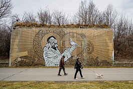 People walking along the Dequindre Cut in Detroit.