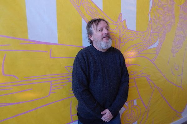 Artist Tim Hailey with his piece at Public Pool