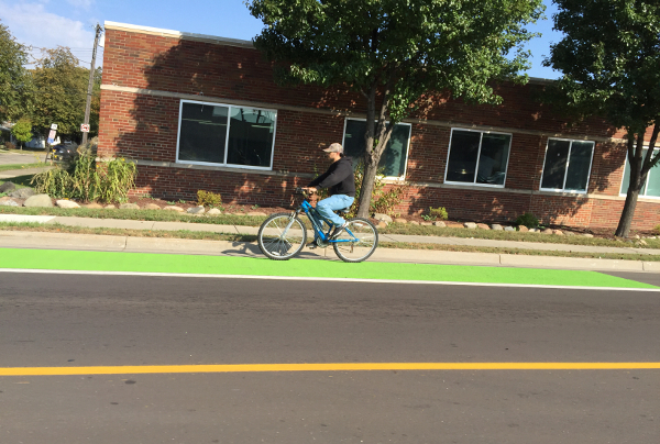 A cyclist rides in a bike lane on W. 9 Mile Road in Ferndale