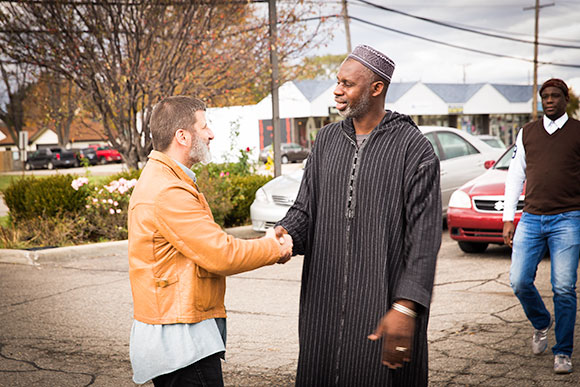 Macomb Muslims gather in front of a mosque before a prayer service