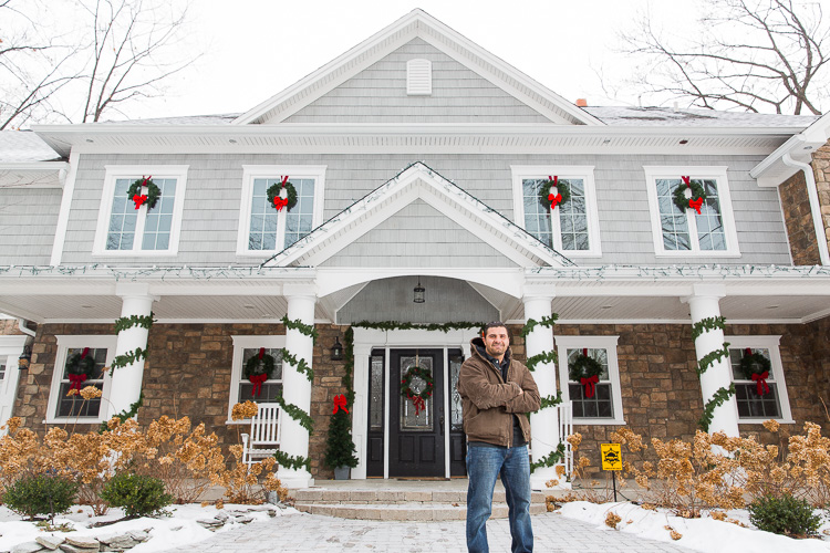 Mike Hammoud in front of his bigfoot house in Dearborn Heights