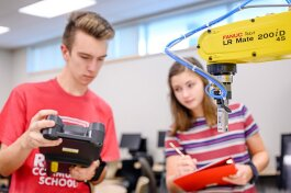 Kyle Gilber and Carsyn Boggio work in the Robotics Lab at the Academies at Romeo.