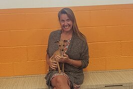 Canine to Five owner Liz Blondy with Tofu, a newcomer to the dog day care.