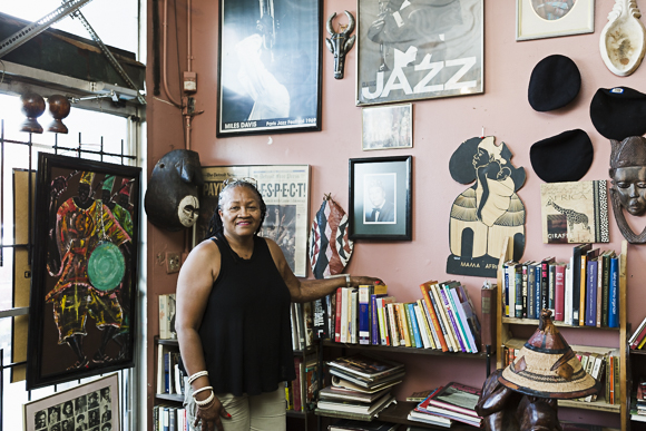 Nandi amongst her cafe's collection of books and art