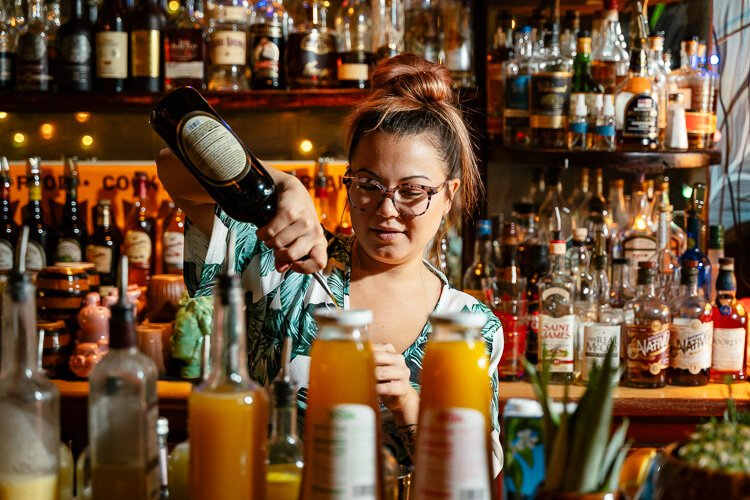 "Ariel Gosselin, Lost River's ""Curator of Libations,"" mixes a drink."