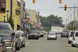 Saginaw Street in downtown Bay City lined with American flags