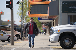 A pedestrain walking through Downtown Bay City - Avram Golden
