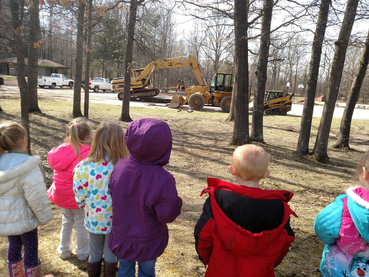 Children watch as West Midland Family Center completes renovation work earlier this year