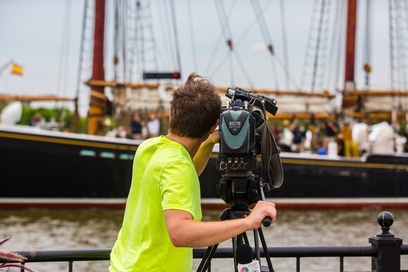 Professional and amateur photographers and videographers greeted the ships.