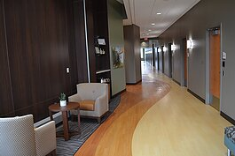 The hallway leading to patient rooms features a domestic vibe to aid in stress reduction during medical visits.