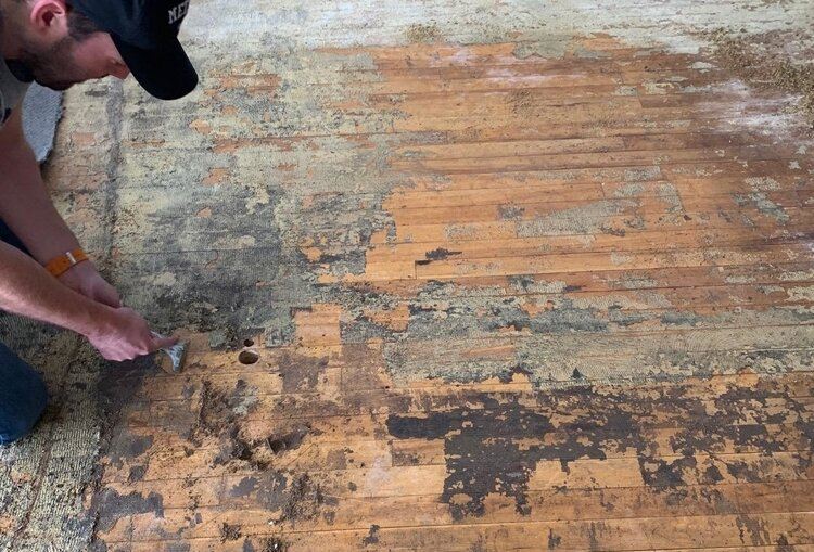 Getting down to the original wood floors.