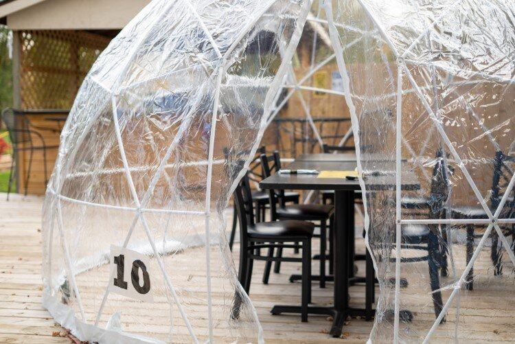 "The Creek Grill now has several ""igloos"" placed throughout their outdoor seating area. The round, enclosed plastic spaces provide seating for groups up to eight."